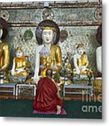 faithful Buddhist monk praying at Buddha Statues in SHWEDAGON PAGODA Metal Print