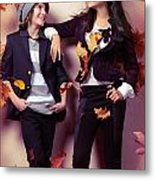 Fashionably Dressed Boy And Teenage Girl Under Falling Autumn Le Metal Print by Oleksiy Maksymenko