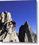 Female Climber Reaching The Top Metal Print