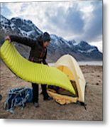 Female Hiker Sets Up Tent On Wild Metal Print