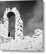 Female Tourist Walks Up The Stepped Seating Area Towards Ruined Archways Of The Old Roman Colloseum At El Jem Tunisia Metal Print