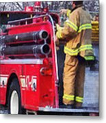 Fireman On Back Of Fire Truck Metal Print