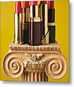 Five Red Lipstick Tubes On Pedestal Metal Print by Garry Gay