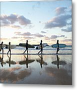Five Surfers Walk Along Beach With Surf Metal Print