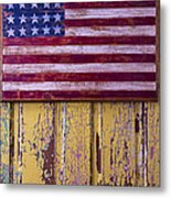 Flag On Old Yellow Door Metal Print