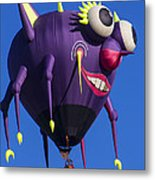 Floating Purple People Eater Metal Print by Garry Gay