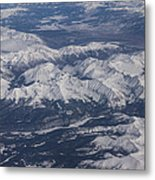 Flying Over The Snow Covered Rocky Mountains Metal Print