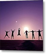Friends Jumping Against Sunset Metal Print