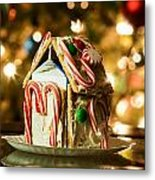 Gingerbread House Against A Background Of Christmas Tree Lights Metal Print