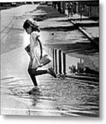 Girl Playing In A Puddle Metal Print by Retro Images Archive