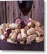 Glass Of Wine With Corks Metal Print