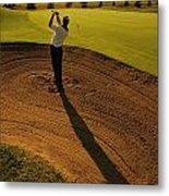 Golfer Taking A Swing From A Golf Bunker Metal Print
