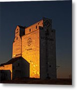 Sunset Grain Elevator At Meadows Metal Print by Steve Boyko