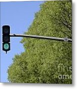 Green Traffic Light By Trees Metal Print by Sami Sarkis