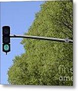 Green Traffic Light By Trees Metal Print