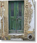 Green Wood Door With Hand Carved Stone In The Medieval Village Of Obidos Metal Print