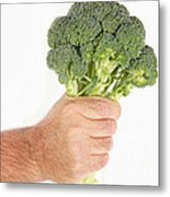 Hand Holding Broccoli Metal Print