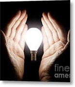 Hands Holding Light Bulb Metal Print
