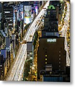 Highway At Night In Osaka With Traffic Metal Print