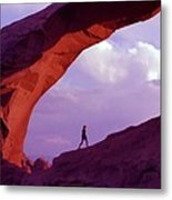 Hiker Beneath Arch Metal Print