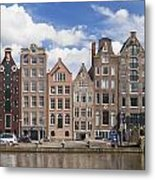 Historic Buildings Along The Damrak Canal In Amsterdam Metal Print