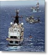 Hms Cornwall Is Pictured Receiving Stores By Merlin Helicopter  Metal Print