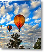 Hot Air Balloons Over Trees Metal Print