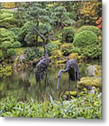 Japanese Bronze Cranes Sculpture By Pond Metal Print