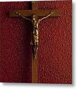 Jesus On Cross Against Red Wall Metal Print