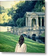 Lady Sitting On A Hill Above A Lake Metal Print