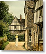 Lady Walking In The Village Metal Print by Jill Battaglia