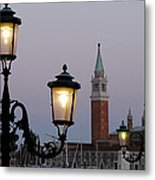 Lampposts Lit Up At Dusk With Building Metal Print