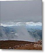 Land And Clouds Converge Metal Print