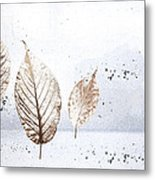 Leaves In Snow Metal Print