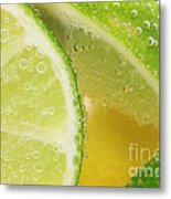 Lemon And Lime Slices In Water Metal Print