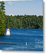 Lighthouse And Boathouse Metal Print
