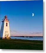 Lighthouse In The Light From Moon And Sun Metal Print