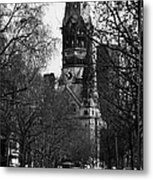 looking down Kurfurstendamm towards Kaiser Wilhelm Gedachtniskirche memorial church Berlin Germany Metal Print by Joe Fox