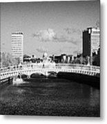 Looking Down The Liffey Towards The Hapenny Ha Penny Bridge Over The River Liffey In Dublin Metal Print by Joe Fox