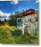 Love Graffiti Covered Building In Field Metal Print