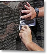 Man Getting A Rubbing Of Fallen Soldier's Name At The Vietnam War Memorial Metal Print