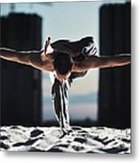 Man Holding Yoga Pose In The Sand Metal Print