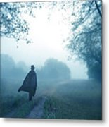 Man In Top Hat And Cape On Foggy Dirt Road Metal Print
