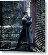 Man In Trenchcoat Lighting A Cigarette Metal Print