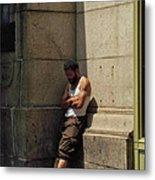 Man Leaning Against Wall In Sun Metal Print
