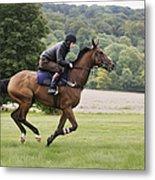 Man on a bay horse galloping across grass. Metal Print