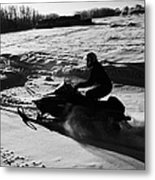 man on snowmobile crossing frozen fields in rural Forget Saskatchewan Metal Print by Joe Fox