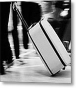 man pulling red wheeled luggage out of Reina Sofia Sur TFS South Airport Tenerife Canary Islands Spain Metal Print