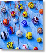 Marbles On Blue Board Metal Print