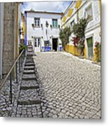 Medieval Cobblestone Street In The Fortified Walled European Village Of Obidos Metal Print